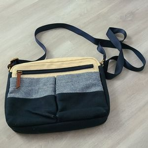 Fossil soft jean material cross body bag.